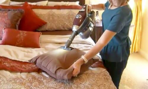 The Shark® Rocket® DeluxePro easily cleans upholstry.